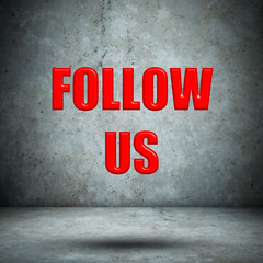 FOLLOW US on concrete wall