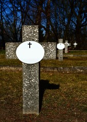 The cross on the grave of an unknown person. Abandoned cemetery.