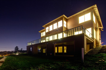 House with lights on. NIght view