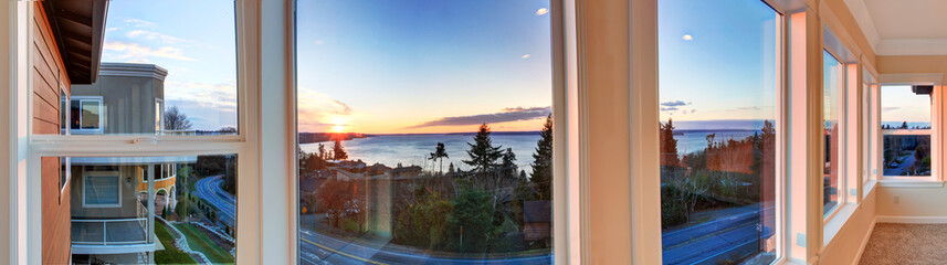 Beautiful sunset view through the windows. Panoramic picture
