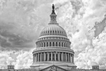 Washington DC Capitol on cloudy sky in black and white
