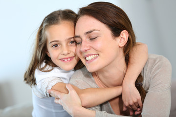 Portrait of mother and daughter in tender moment