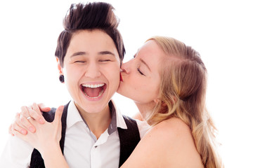 Woman kissing to her lesbian partner