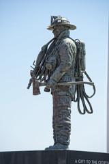 Fireman Statue on the light blue sky background
