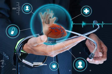 Smart hand showing human heart and stethoscope
