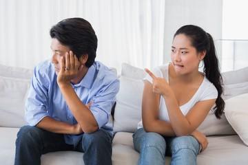 Couple having a dispute on the sofa