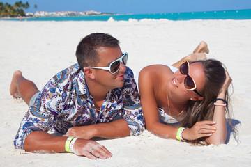Couple on the caribbean beach of sea