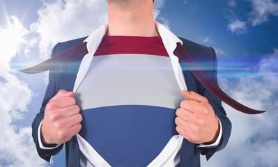 Businessman opening shirt to reveal netherlands flag