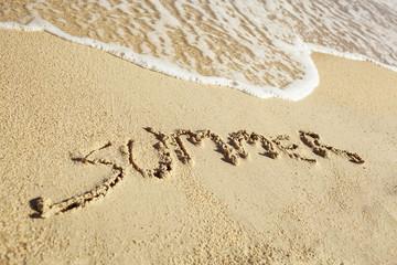 Handwritten summer on sand