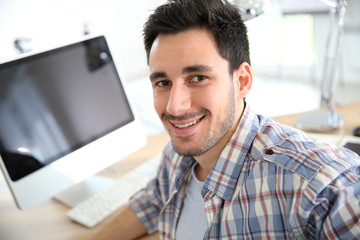 Smiling young adult in office
