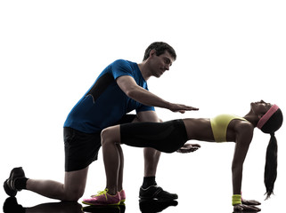 Wall Mural - woman exercising plank position fitness workout with man coach s