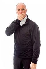 Senior man with hand over mouth