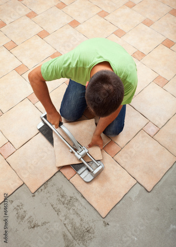 Worker Cutting Ceramic Floor Tile Stock Photo And Royalty Free