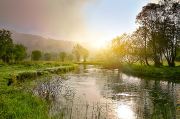 Photo sur Plexiglas Miel Sunrise on a smal river with fog