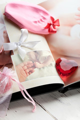 Baby's photobook and a footprint keepsake