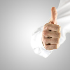 Showing thumbs up sign