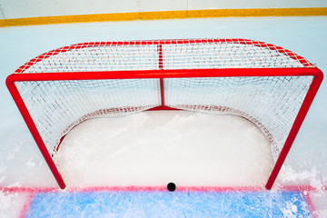 Hockey goal with puck on red line