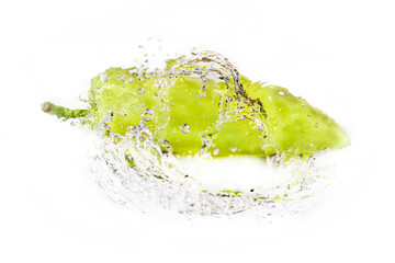 green pepper with water splash isolated