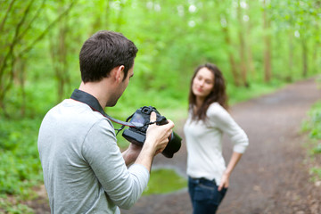 Photographer taking picture of an attractive model