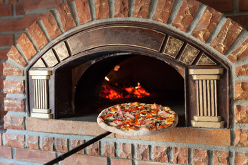 Wall Mural - Pizza on traditional oven
