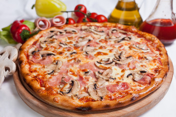 Wall Mural - Pizza with mozzarella, ham and mushrooms
