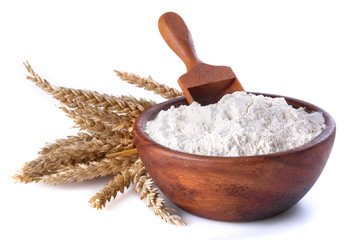 flour with wheat in a wooden bowl and shovel
