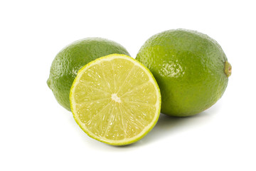 Lime and a slice isolated on white