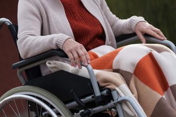Elderly lady on wheelchair outdoors