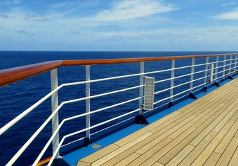 Cruise ship deck and rail overlooking the sea