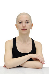 Bald woman in black sleeveless shirt, isolated