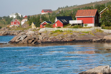 Red and yellow wooden fishing cabins in Norway