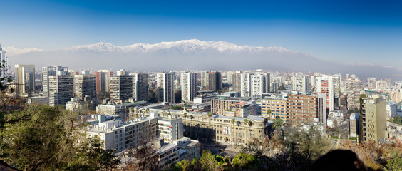 Aerial view of a city and The Andes mountain in the background,