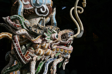 the dragon sculpture in a temple in vietnam