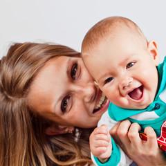 Happy mum with the baby