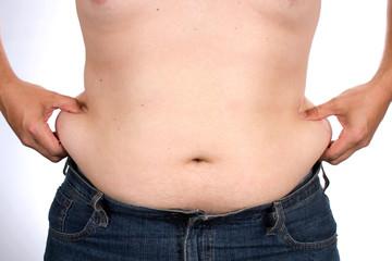 Man Pinching His Belly Fat Around Waist