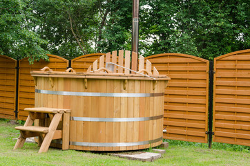 modern wooden water hot tub with stairs outdoor