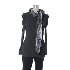female elegant dress with scarf and trousers on n mannequin