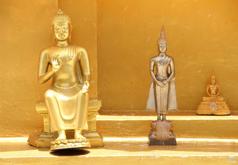 Three golden Buddha statue in three actions