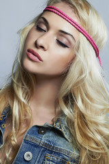 beautiful girl in jeans.blond woman with curly hair.hippie style