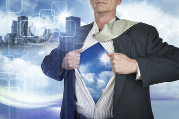Businessman showing superhero suit underneath his shirt standing