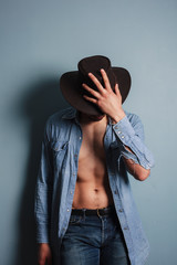 Sexy young cowboy with his shirt open