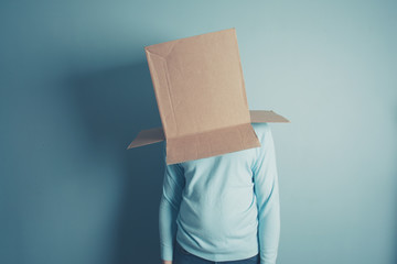 Man with a cardboard box over his head