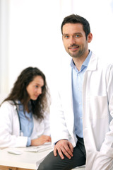 Portrait of a doctor and a nurse working