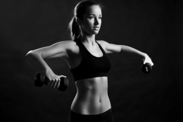 fitness woman at black background