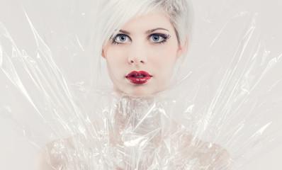 Pretty girl model in plastic