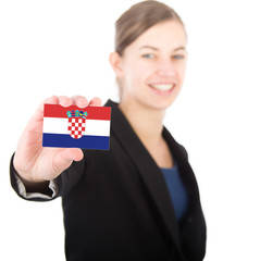 business woman holding a card with the flag of Croatia
