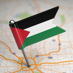 Palestine Small Flag on a Map Background.