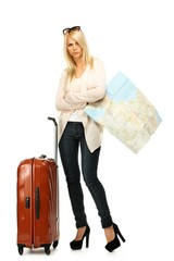 Displeased blond woman with suitcase and map