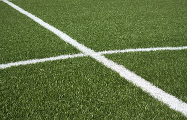 Center a soccer field with synthetic grass and white lines