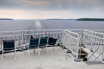 Fotobehang Inspirerende boodschap Chairs on the deck of a ferry, Lake Huron, Georgian Bay, Tobermo